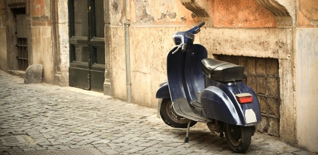 Scooters are often preferable to cars in the narrow streets of Italian towns.