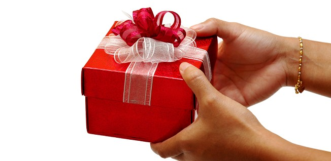 Gifts should be wrapped in red or pink and be presented with both hands.