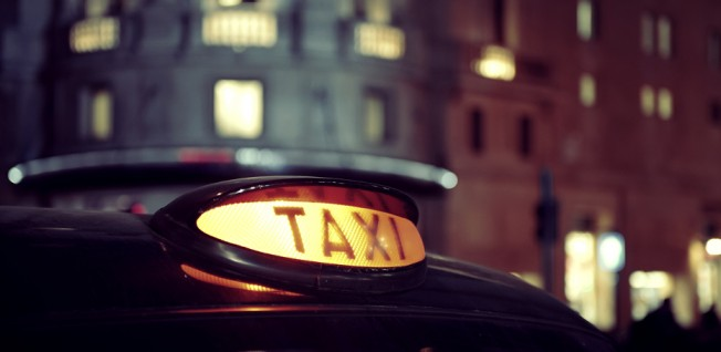 Taxis offer a convenient if costly way to travel in British cities.
