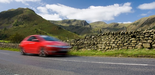 On rural roads, such as this route in Britain's scenic Lake District, the speed limit is usually 96 km/h (60 mph).