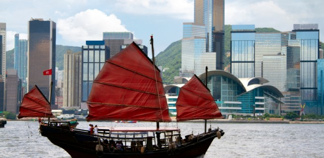 Life in Hong Kong combines Chinese tradition and new urban development.