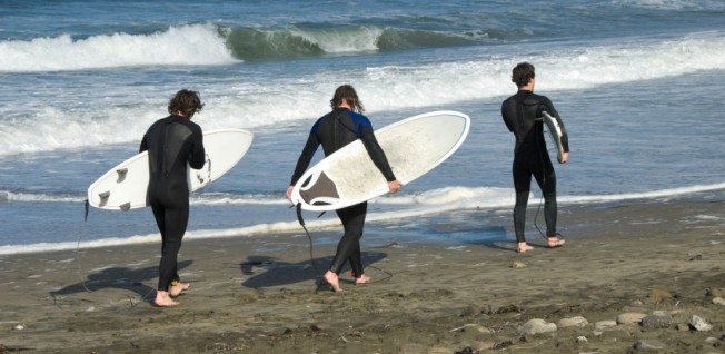 Surfing is a popular hobby for expats and locals living near US coasts.