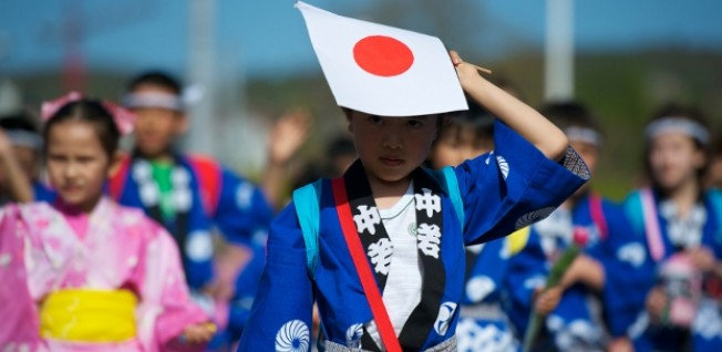 There are many expat kids in Zurich. This Japanese boy is part of the parade at the local spring festival.