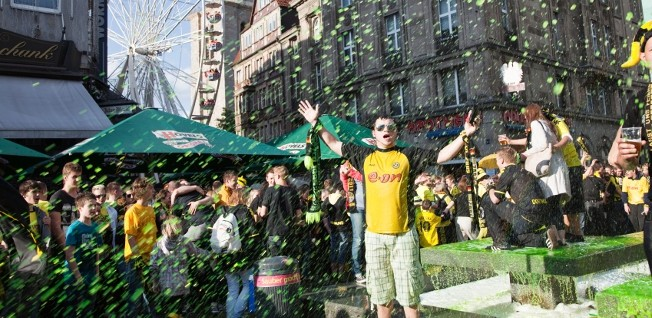 "Football (soccer) is by far the most popular spectator sport in Germany. Here fans celebrate ""their"" team's success."
