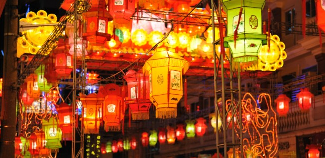 At night, colorful lanterns illuminate the streets of Shanghai.