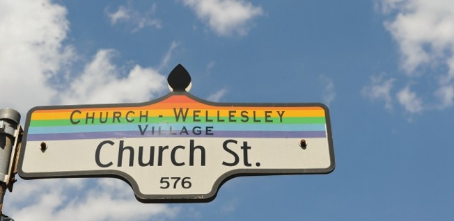 Many street signs in Toronto also denote the neighborhood and its particular characteristic feature.