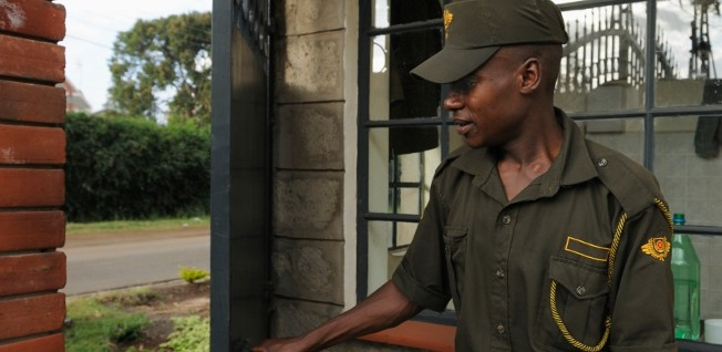 """Many people in Nairobi hire a private security guard or """"askari""""."""