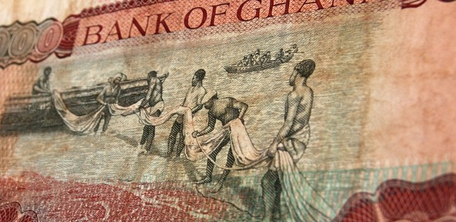 The old Cedi bills displayed distinctive features of the Ghanaian economy, such as fishing pictured above.