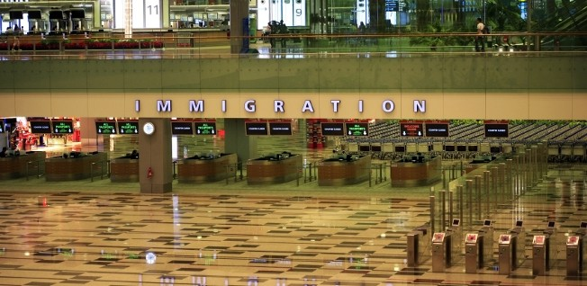 There are several thousand expats with a permanent resident status in Singapore.