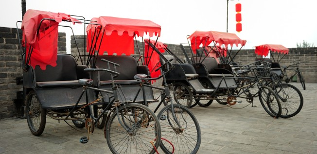 Rickshaws are one alternative means of urban transport in China.