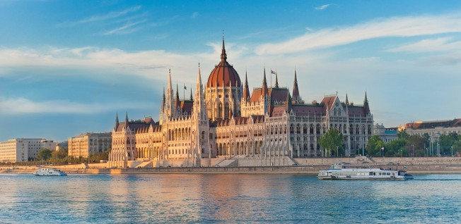 Budapest's Parliament Building is located in District 5, right at the Danube River.