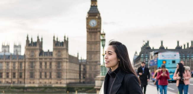 asian businesswoman in london (big ben in background)