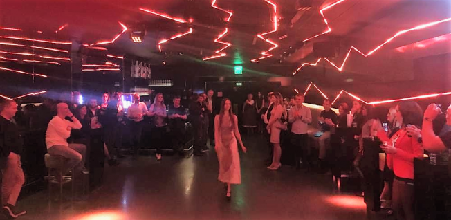 Fashion Show in a Club with Red & Pink Stroboscope Lights