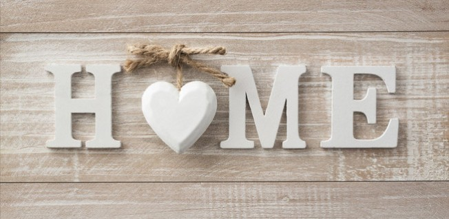Home_White Sign_Wooden Background