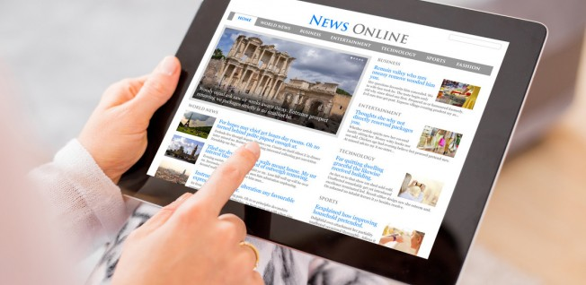 Business News on Tablet Screen