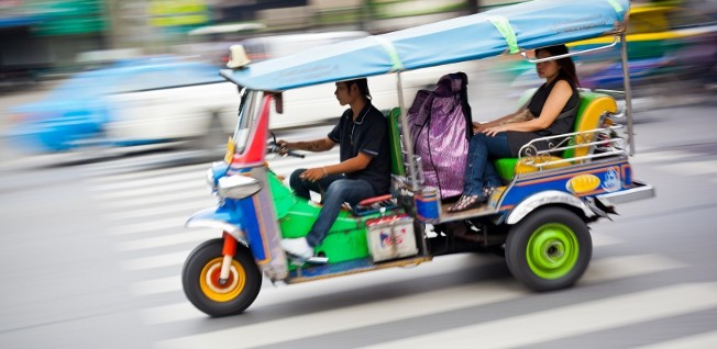 Don't judge them by their size: tuk-tuks are a popular mode of transportation in Thailand and they drive like they rule the roads.
