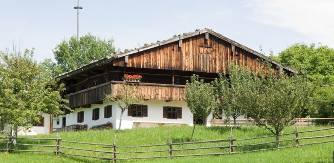 In the countryside south of Munich, such Bavarian-style family housing is a common sight.