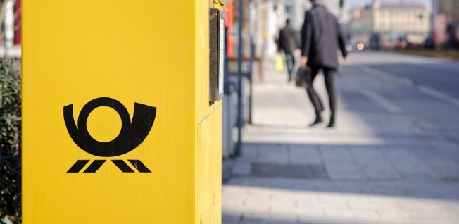 The characteristic yellow mailboxes are located all over German towns and are emptied regularly.