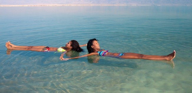 Taking a bath in the high-saline water of the Dead Sea is said to be beneficial for your health.