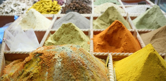 Save money by cooking for yourself instead of eating out; there are plenty of spices available in Qatar's souqs!