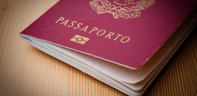 A business/employment visa will allow you to move to Italy.