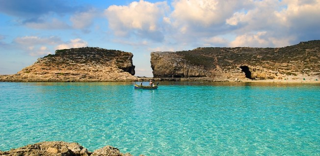 Life's a beach: The picturesque coastlines, such as the famous Blue Lagoon of Comino, are a definite bonus of expat living in Malta.