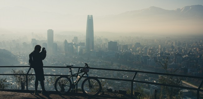 The customary smog over Santiago can pose a health risk to some.
