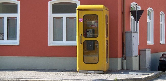 As cell phones have become more popular, the typical yellow phone booths are slowly disappearing.