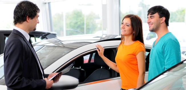 Car dealerships will often take care of the initial paperwork when you are buying a car in the US.
