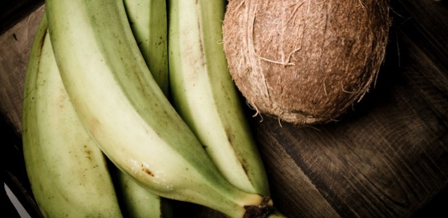 Plantains (banana-like fruits) and coconuts are characteristic of Dominican cuisine.